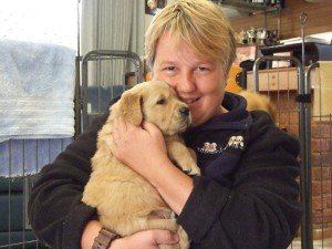 Renowned trainer Dee Moore with a puppy who'll go on to assist a person living with a disability